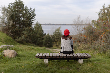 woman sitting on bench in nature