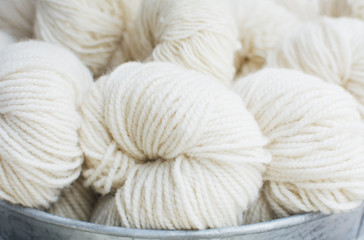 Skeins of white woolen yarn