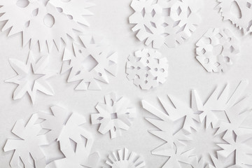 Handmade paper snowflakes made for Christmas decoration on white background