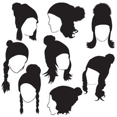 silhouettes of female heads in winter hats