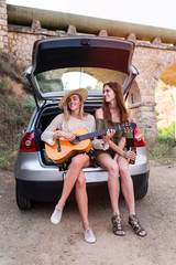 Women friends with guitar