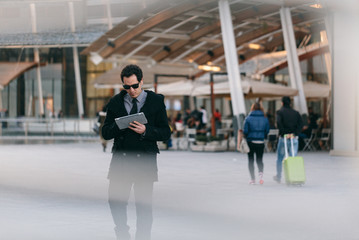 Young businessman using digital tablet in the financial district