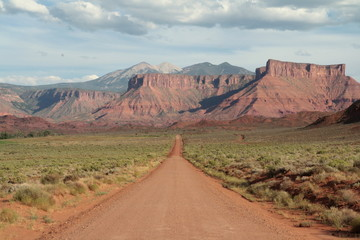 Western country road landscape, Utah, USA. Road leads to nowhere. Perfect background or wallpaper.