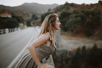 Woman looking nature from a bridge.