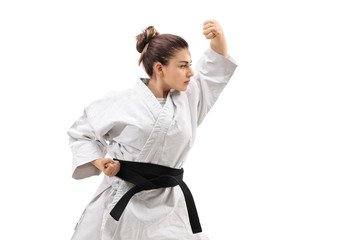 Girl wearing a kimono practicing karate