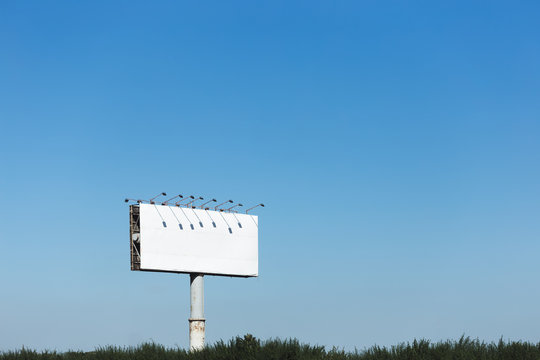 White Billboard Against the Blue Sky