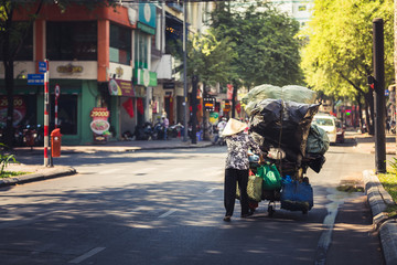Woman carrying a lot of waste materials