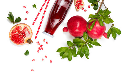 Juice and fruit of pomegranate, above view.