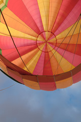 hot air balloon canopy, viewed from within the basket, looking up