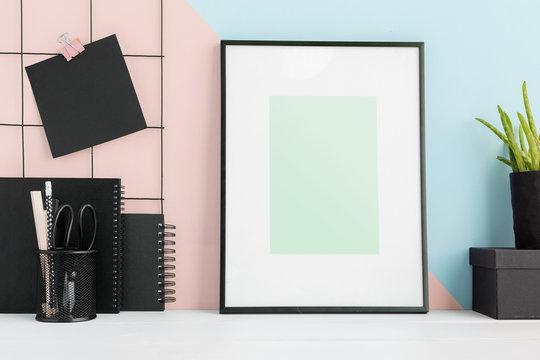 Poster frame on a stylish desk template. Mock up.
