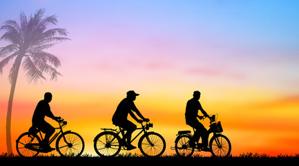 Silhouette man and bike relaxing with  sunrise background.