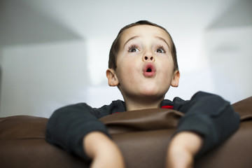 Little Boy Surprised Watching Movie
