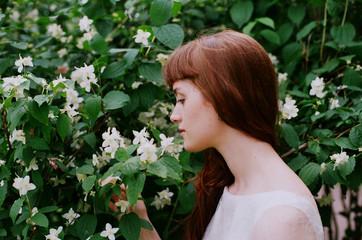 Portrait of the girl with jasmine