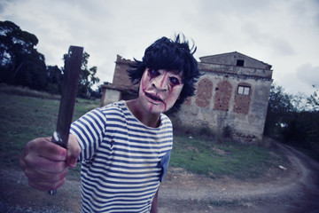 scary disfigured man wielding a cleaver