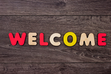 Word Welcome from wooden letters