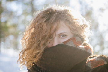 Portrait of a young ginger woman wearing scarf at winter time