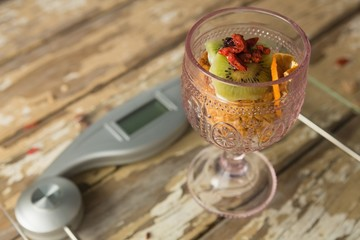 Glass of breakfast on weighing scale