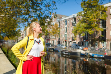 Cheerful young woman in Amsterdam
