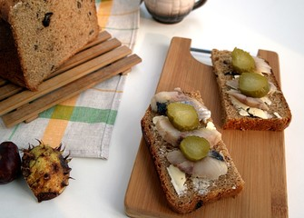 Snack sandwiches with herring and cucumber