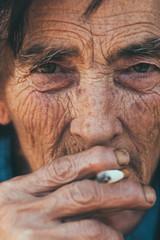Closeup of senior woman smoking