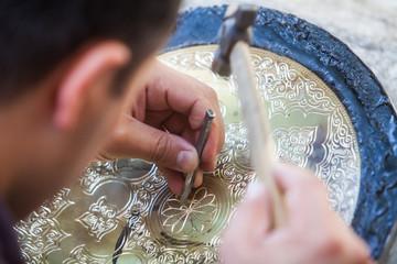 Artisans carving plates