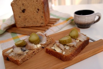 Tasty sandwiches with herring and pickled cucumber