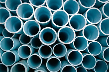 Blue plastic pipes background
