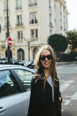 Stylish young woman outdoors in Paris