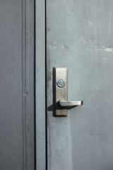 Grey door and lock on building exterior