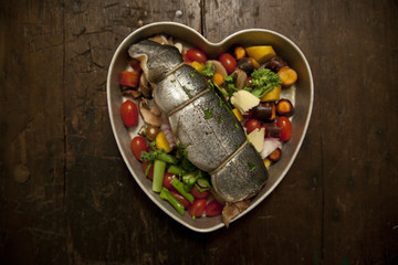 Trout And Vegetables In A Heart Pan