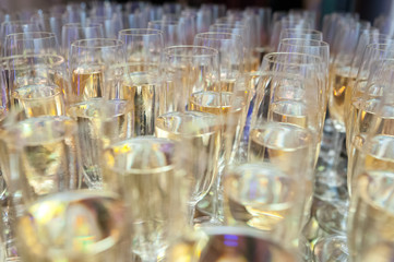 Champagne glasses during celebration.