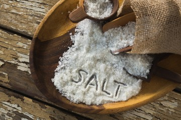 Word salt on wooden plate