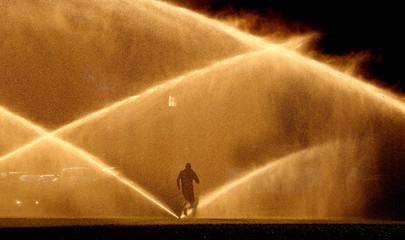 A jogger makes his way past sprinklers in Washington