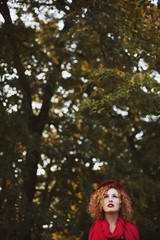 Beautiful ginger haired woman in nature