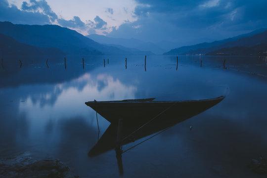Boat tied to a pole in Fewa lake, Pokhara, Nepal.