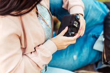 woman holding analogue camera