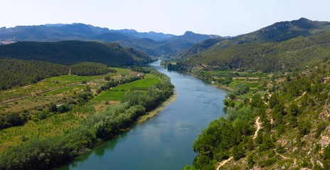 Panorama of Ebro River valley and farm fields in Catalonia, Spain viewed from above. View from Miravet village.