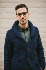 Attractive and fashionable young man wearing glasses
