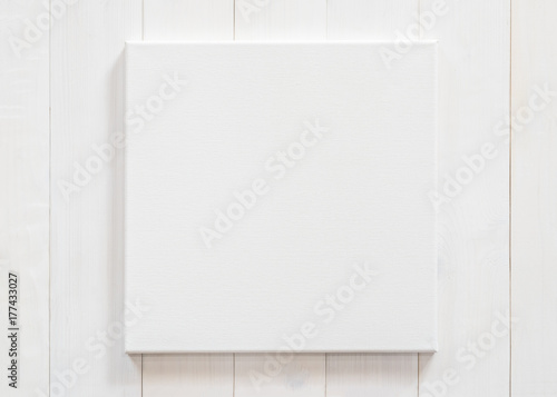 White canvas frame mock up template square size on white wood wall ...