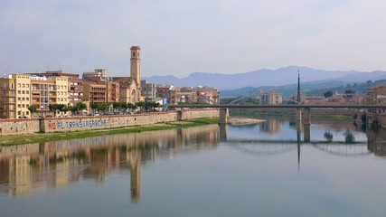 Tortosa, Catalonia, Spain riverside buildings reflected in River Ebro