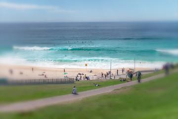 SYDNEY - OCTOBER 2015: People enjoy Bondi Beach. Sydney attracts 15 million people annually