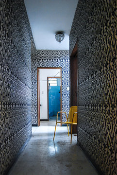 Retro home long corridor with blue wall at the end