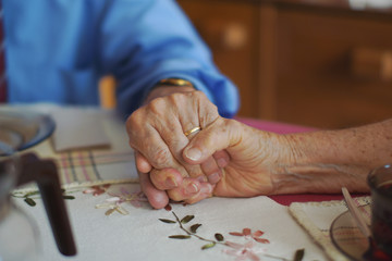 85 years old couple in love holding hands