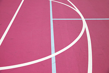 graphic colourful lines on a pink basketball court