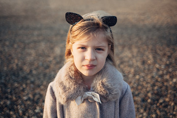 Portrait of a Blonde Girl With a Cat Ears Headband
