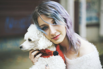 Portrait of a young woman and a dog