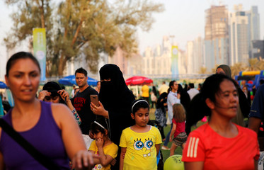 A woman takes pictures during Dubai Fitness Challenge at Safa Park in Dubai