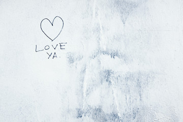 LOVE YA painted on exterior of building wall