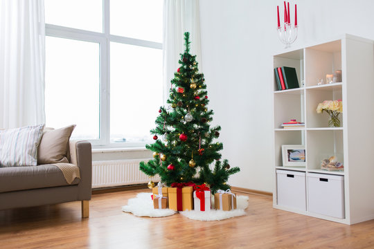 artificial christmas tree and presents at home