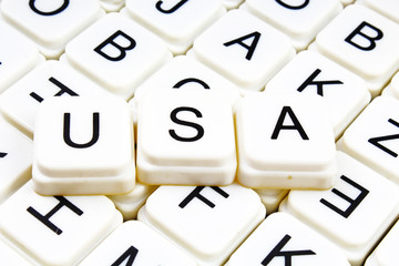 Usa text word crossword. Alphabet letter blocks game texture background.